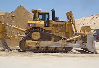 Bulldozers pushed over the sand